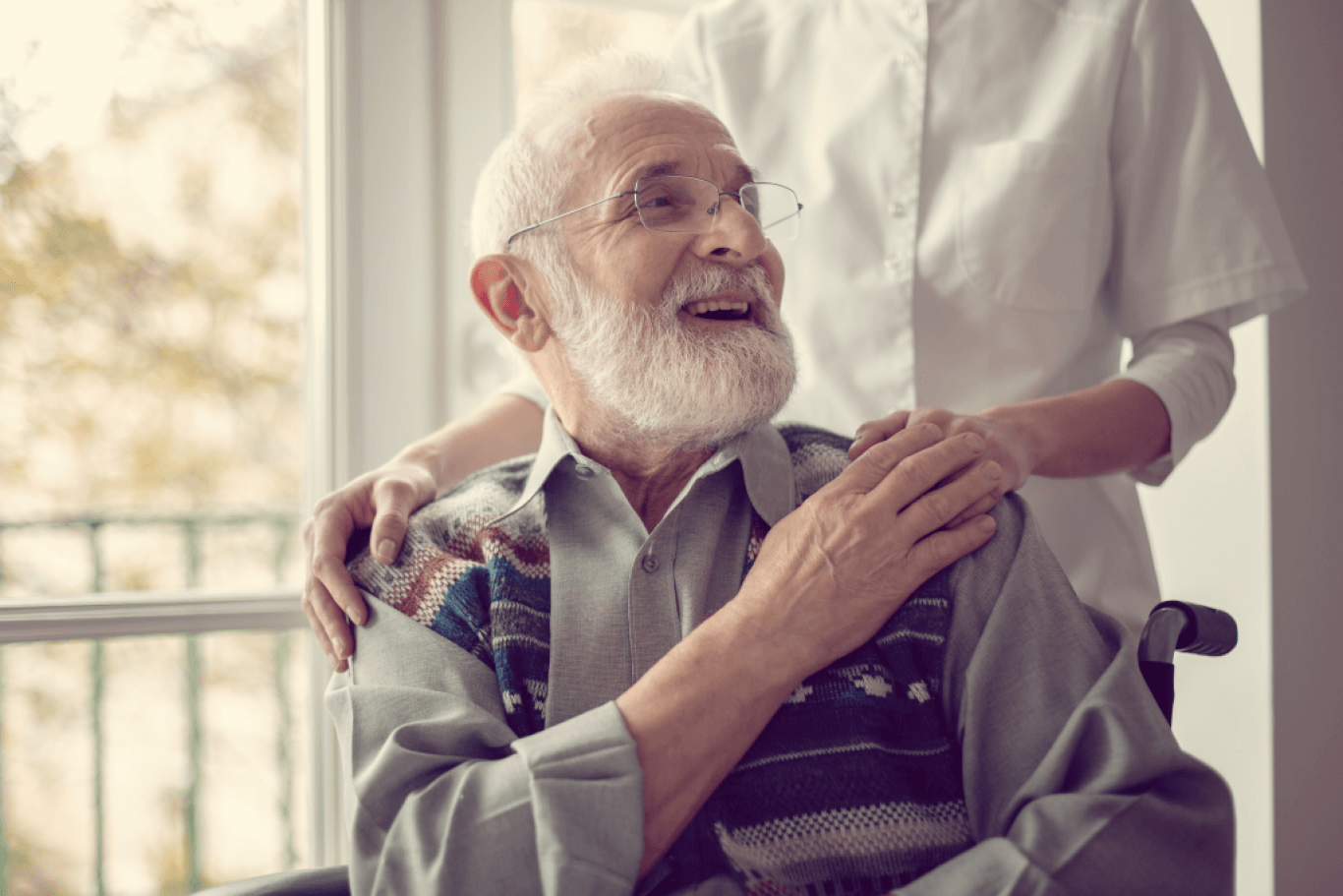 Elderly patient pleasantly engaging with their caregiver